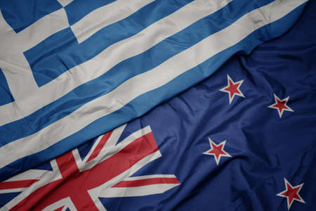 waving colorful flag of new zealand and national flag of greece. macro