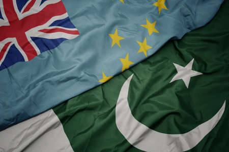 waving colorful flag of pakistan and national flag of Tuvalu ,. macro