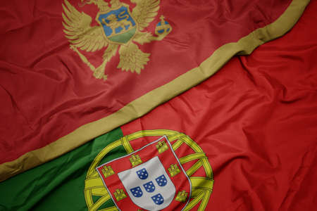 waving colorful flag of portugal and national flag of montenegro. macro