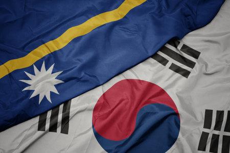 waving colorful flag of south korea and national flag of Nauru ,. macro