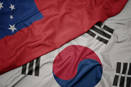 waving colorful flag of south korea and national flag of Samoa ,. macro