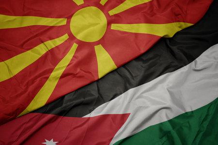 waving colorful flag of jordan and national flag of macedonia. macro Banque d'images