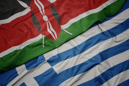 waving colorful flag of greece and national flag of kenya. macro Stock Photo
