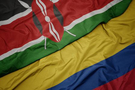 waving colorful flag of colombia and national flag of kenya. macro Stock Photo