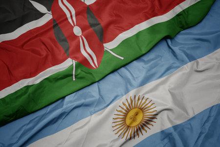 waving colorful flag of argentina and national flag of kenya. macro