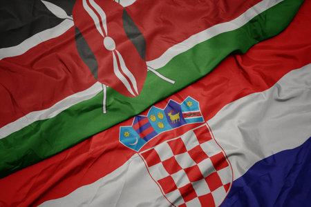 waving colorful flag of croatia and national flag of kenya. macro Stock Photo