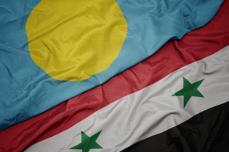 waving colorful flag of syria and national flag of Palau . macro