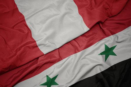 waving colorful flag of syria and national flag of peru. macro