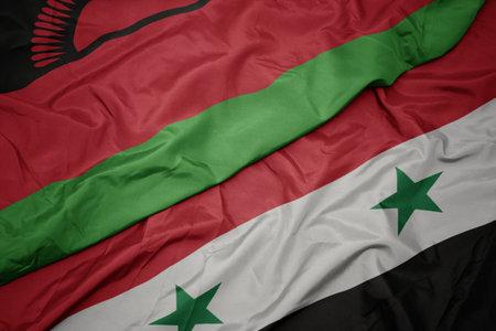 waving colorful flag of syria and national flag of malawi. macro