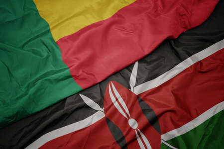 waving colorful flag of kenya and national flag of benin. macro Stock Photo