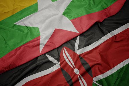 waving colorful flag of kenya and national flag of myanmar. macro