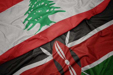 waving colorful flag of kenya and national flag of lebanon. macro