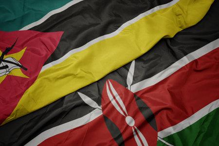 waving colorful flag of kenya and national flag of mozambique. macro