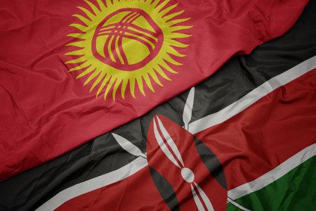 waving colorful flag of kenya and national flag of kyrgyzstan. macro