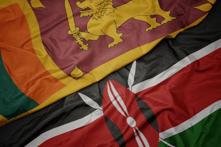 waving colorful flag of kenya and national flag of sri lanka. macro