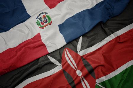waving colorful flag of kenya and national flag of dominican republic. macro Stock Photo
