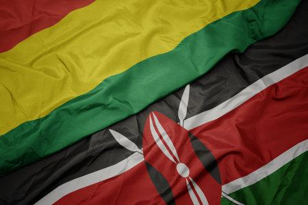 waving colorful flag of kenya and national flag of bolivia. macro
