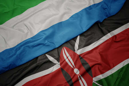 waving colorful flag of kenya and national flag of sierra leone. macro