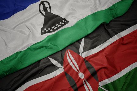 waving colorful flag of kenya and national flag of lesotho. macro Stock Photo