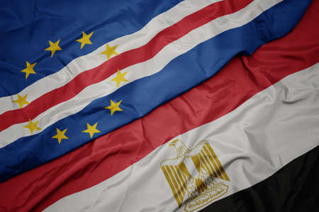 waving colorful flag of egypt and national flag of cape verde. macro Stock Photo