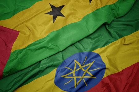waving colorful flag of ethiopia and national flag of sao tome and principe . macro