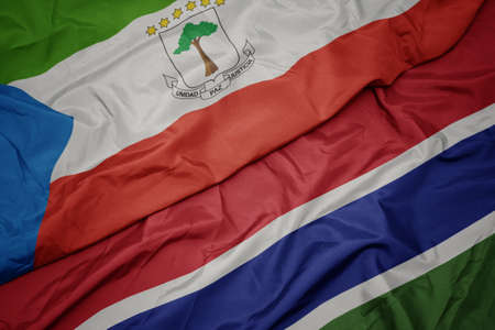waving colorful flag of gambia and national flag of equatorial guinea. macro Stock Photo