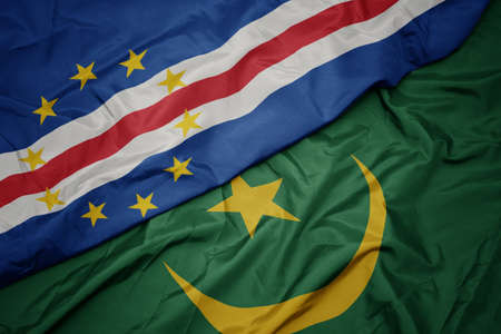 waving colorful flag of mauritania and national flag of cape verde. macro
