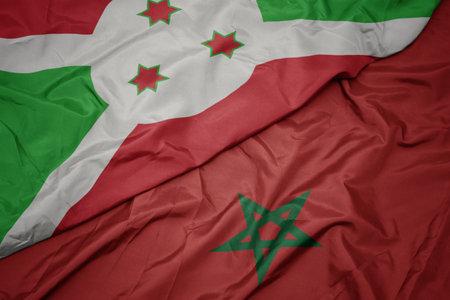 waving colorful flag of morocco and national flag of burundi . macro Stock Photo