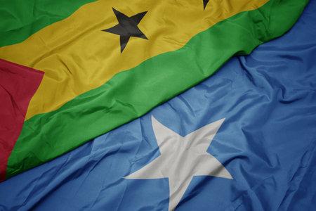 waving colorful flag of somalia and national flag of sao tome and principe . macro