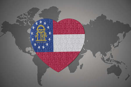 puzzle heart with flag of georgia state on a world map background. 3D illustration