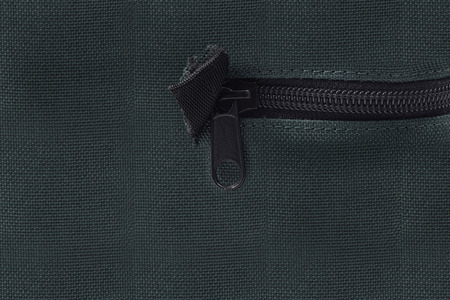 unzipping: Zipped inside textured material Stock Photo