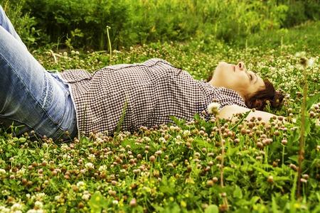 beatitude: Women rest on green grass