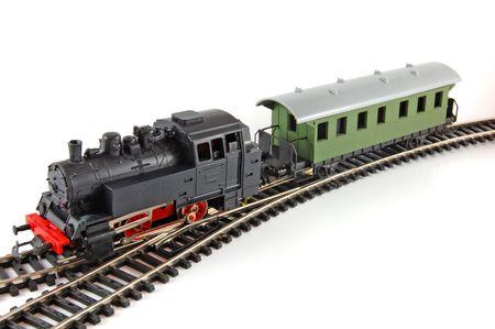 locomotoras: Tren de vapor de juguete y caboose sobre fondo blanco Foto de archivo