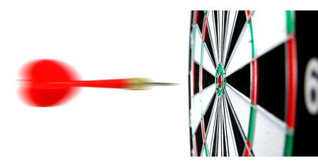 Dartboard with flight of dart on the bullseye photo