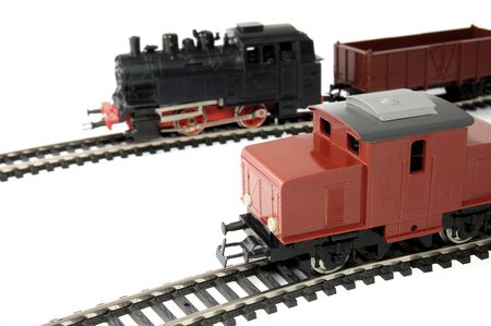 Toy Diesel Locomotive and Steam Train with freight wagon photo