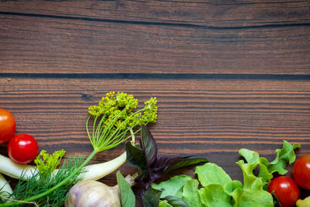 Autumn fresh vegetables on wooden table background