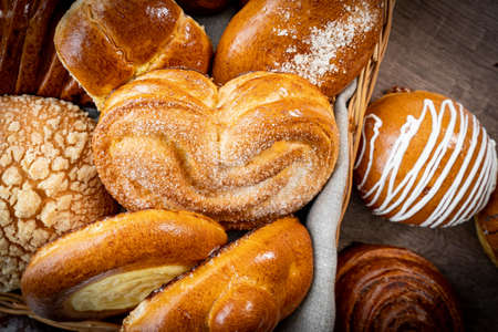 Fresh pastries buns wicker basket rustic style bakery wheat