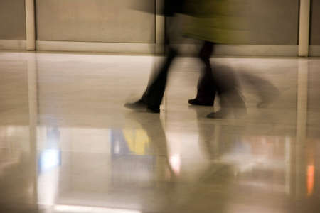rushed: a shot of peoples feet as they walk through an airport