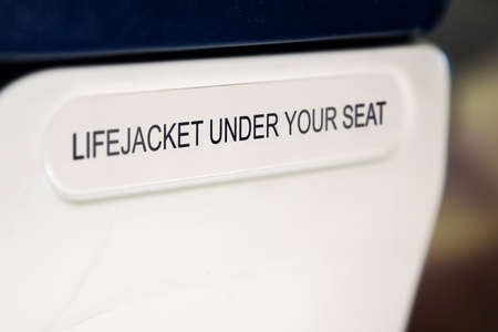 lifejacket: lifejacket sign on the back of airplanes seat