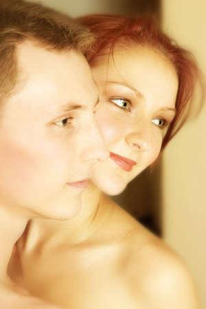 lovemaking: Couple standing cheek to cheek Stock Photo