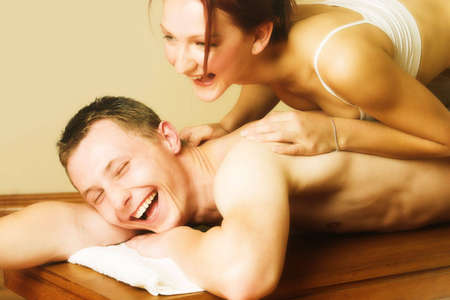 Couple having fun during a massage