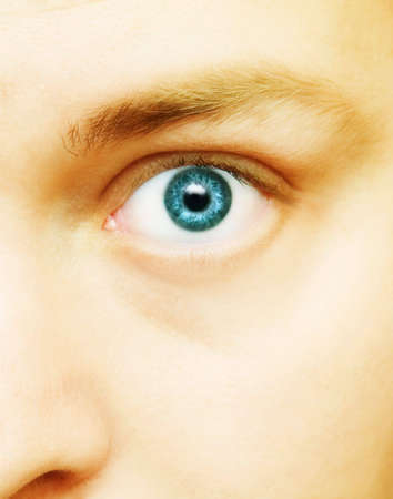 30s: blue large eye  of a white male in his 20s - 30s
