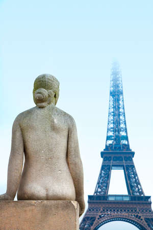 naked statue: Statue of woman at the Trocadero overlooking Eiffel Tower winter time in Paris, France