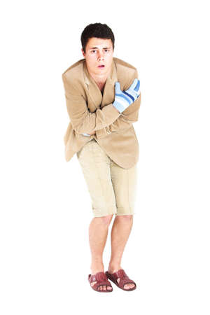 Freezing young man wearing plastic shoes and shorts