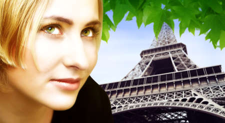 Beautiful blond woman on Eiffel Tower in summer background. Tower is in soft focus. Stock Photo - 1583647