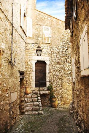 vence:  narrow cobble street with sandstone houses in a village of Saint-Paul de Vence, France