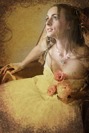 Beautiful happy young bride with long brown hair in white tule petticoat and vinatge and antique accessories sitting on a chair holding pink spring peony on grunge scrolls background photo
