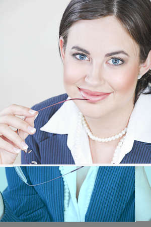 Portrait of successful brunette business woman with natural make-up wearing pinstripe suit, smiling and holding glasses  photo