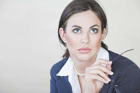 Portrait of successful brunette business woman with natural make-up wearing pinstripe suit  photo