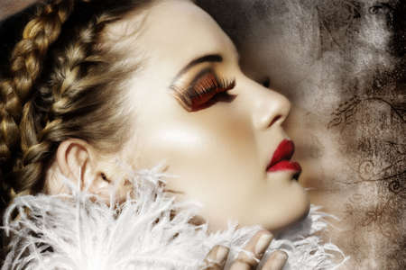 Victorian fashion woman with braids, white feathers, red fantasy lashes and scarlet lipstick on grunge background Ð my designr